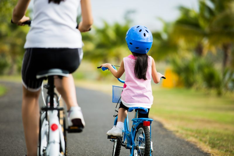 mother cycling with daughter